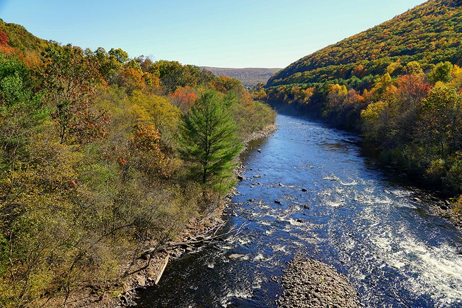 Williamsport, PA Insurance - The Wide Susquehanna River Rushing Between Two Mountains in Autumn